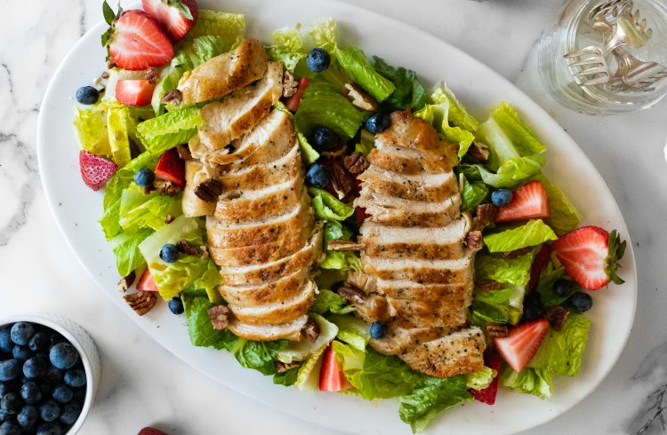 salad with berries, pecans, and pan seared chicken